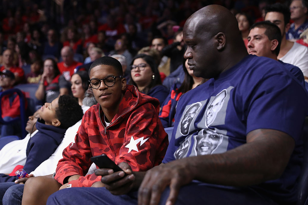 NBA legend Shaquille O'Neal (R) and son Shareef attend a college basketball game between the Arizona Wildcats and the Sacred Heart Pioneers | Christian Petersen/Getty Images