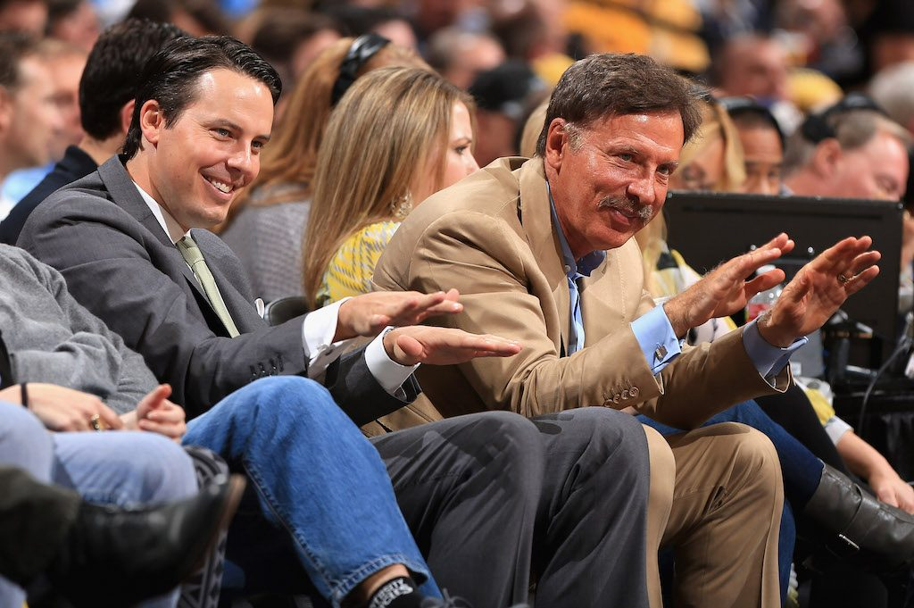 Stan Kroenke bows down from his seat on the sideline after his team scored.
