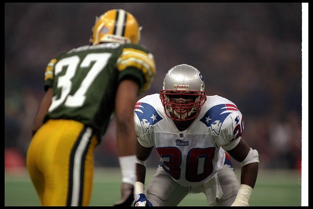 Defensive back Corwin Brown of the New England Patriots faces off against a member of the Green Bay Packers.