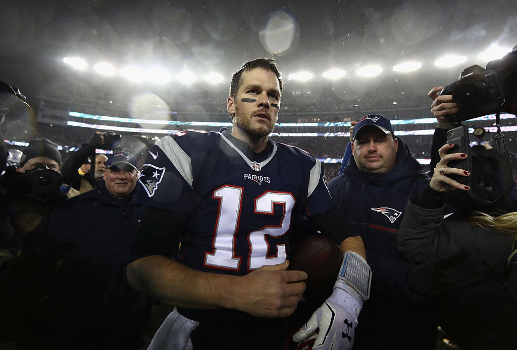 Tom Brady walks off the field after punching a ticket to the Super Bowl 51.