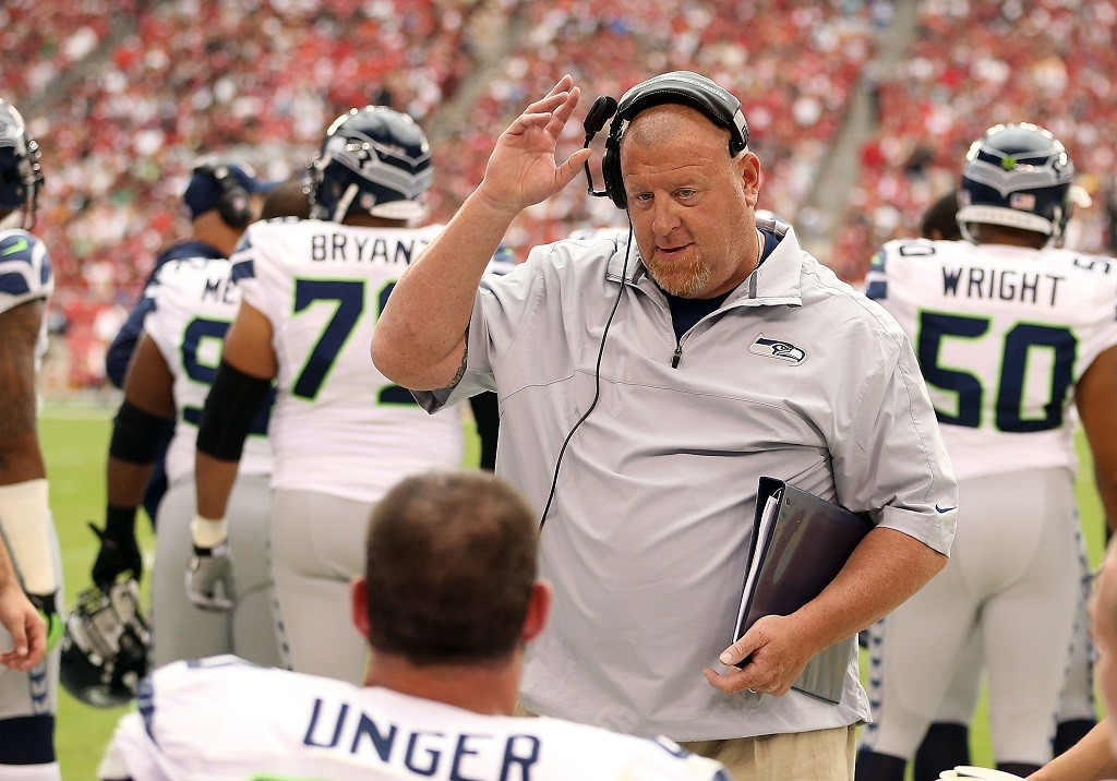 Offensive line coach Tom Cable of the Seattle Seahawks talks during a game