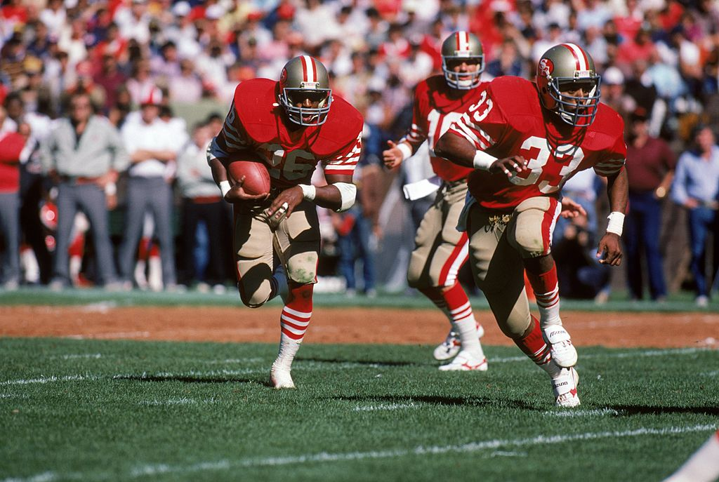 Running back Wendell Tyler of the San Francisco 49ers runs behind the protection of teammate running back Roger Craig.
