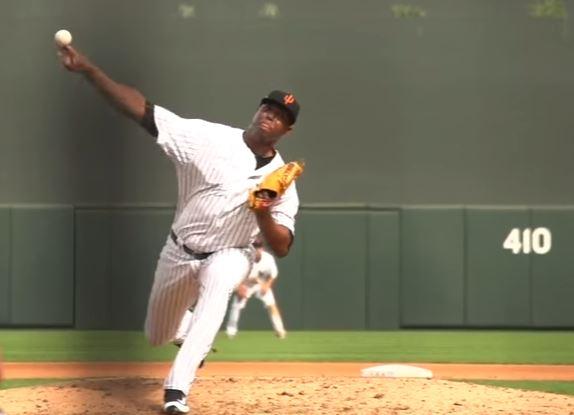 Domingo Acevedo follows through on a pitch