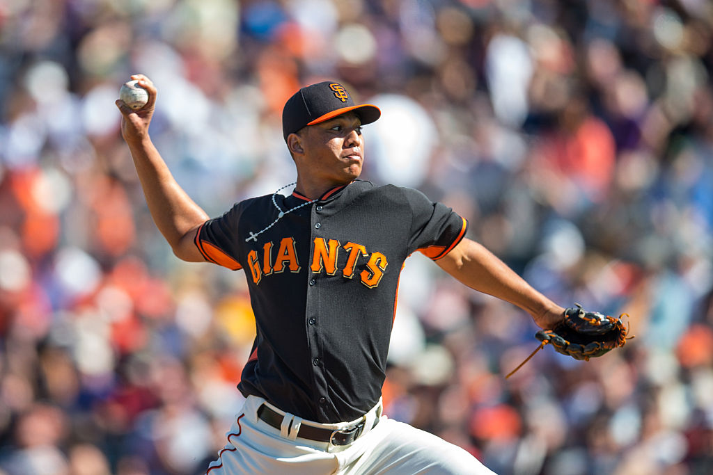 Joan Gregorio of the San Francisco Giants pitches during a spring training game against the Oakland Athletics