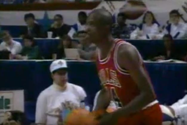 Craig Hodges going up for a three.