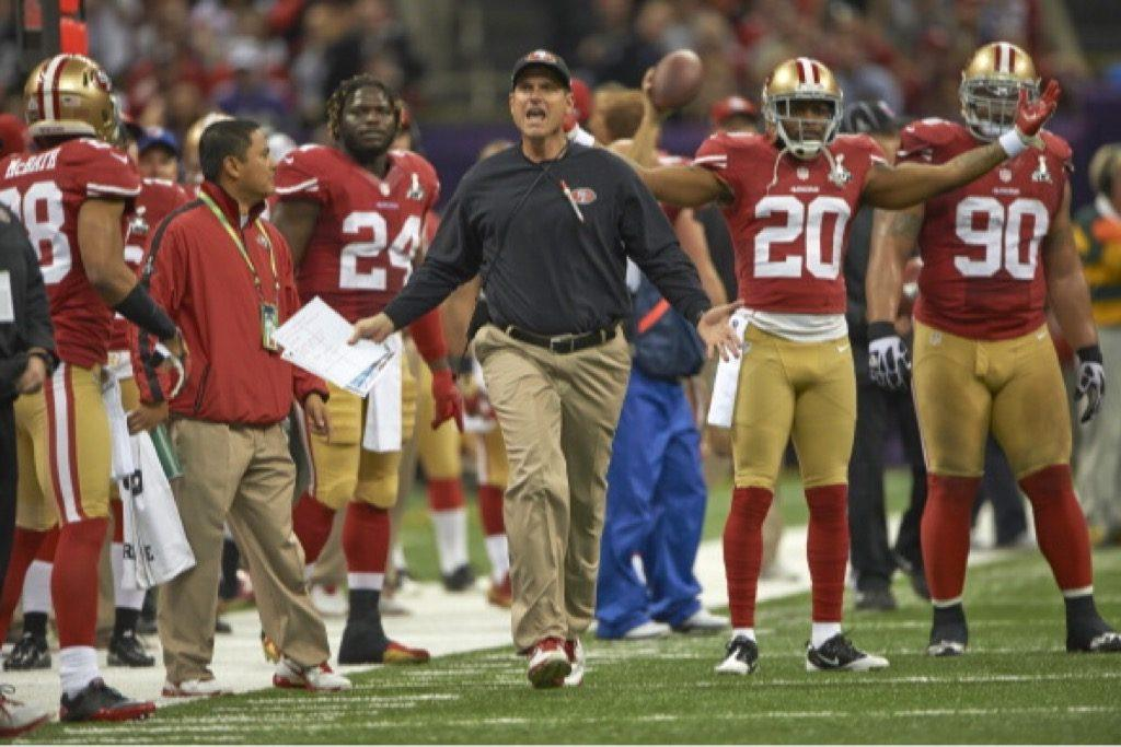 San Francisco 49ers head coach Jim Harbaugh argues a call.