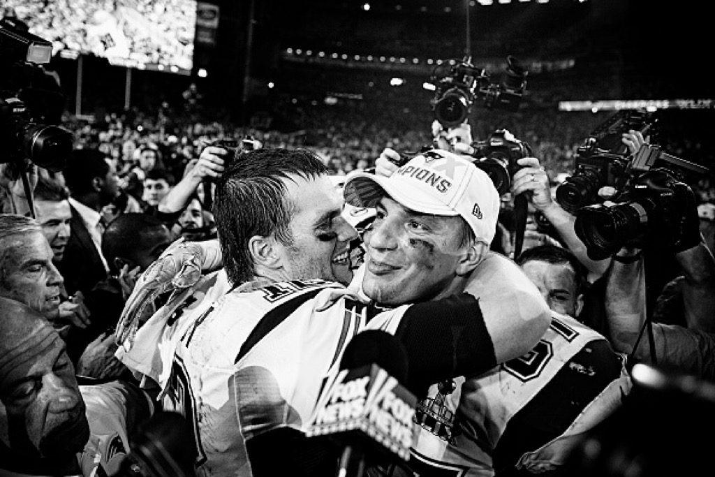 Quarterback Tom Brady congratulates his teammate Rob Gronkowski after winning Super Bowl XLIX.
