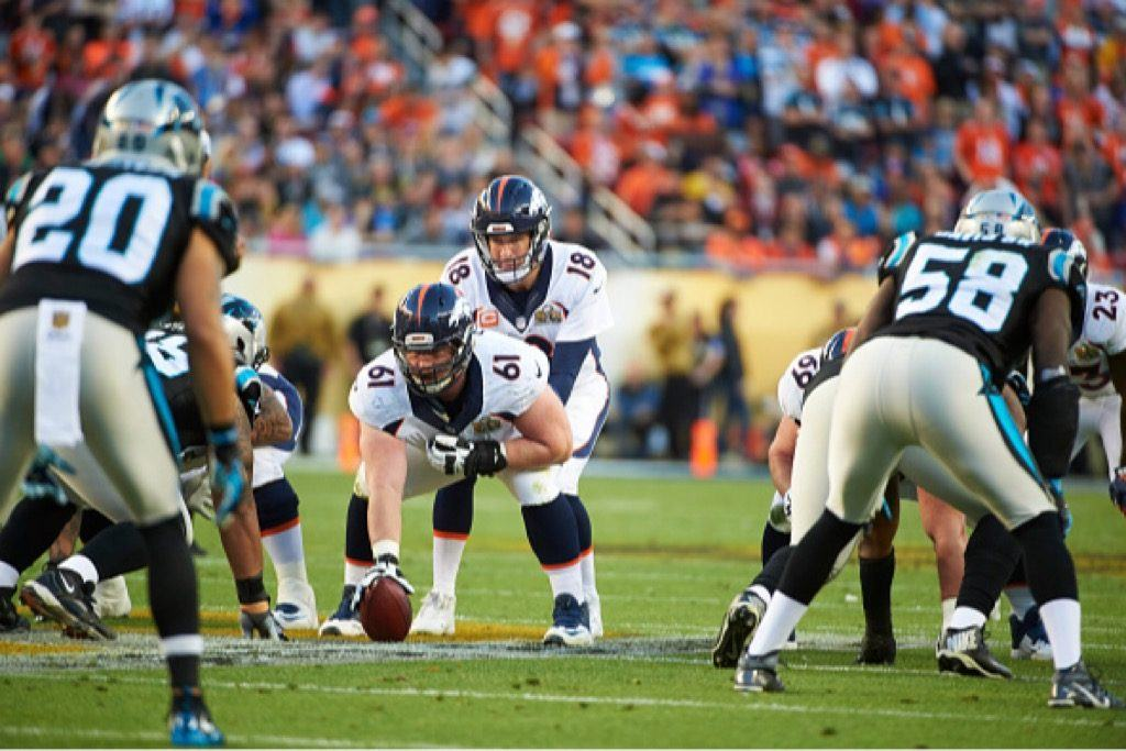 Denver Broncos QB Peyton Manning prepares at the line of scrimmage.