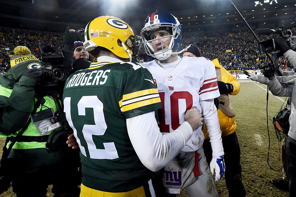 Aaron Rodgers of the Green Bay Packers and Eli Manning of the New York Giants meet after the wild-card game.