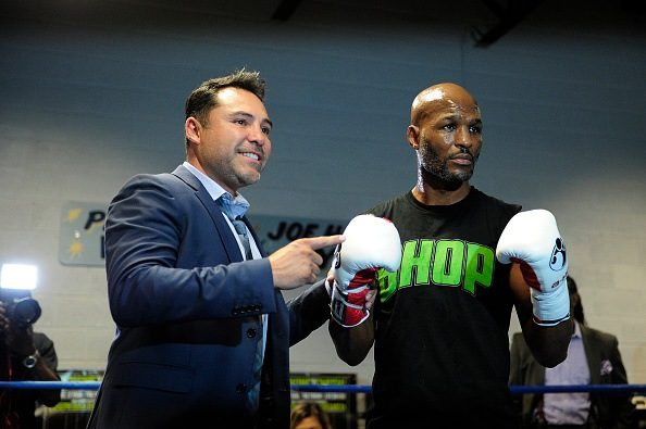 Bernard Hopkins (L) poses for a photo with Oscar De La Hoya, boxing great and Chairman and CEO of Golden Boy Promotions.