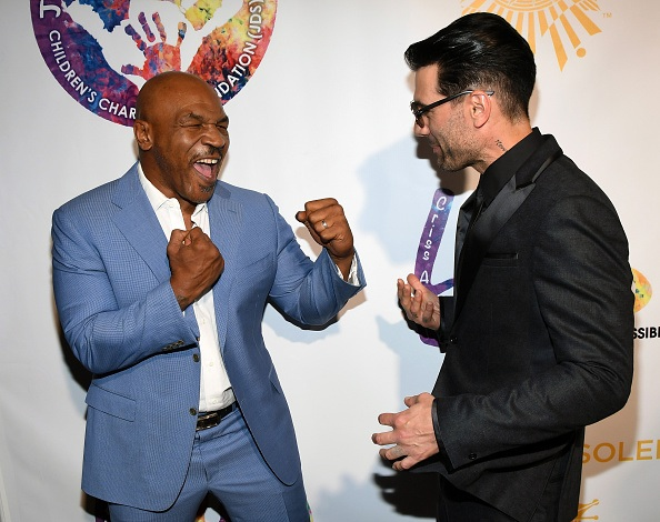 Former boxer Mike Tyson and illusionist Criss Angel joke around as they attend Criss Angel's HELP (Heal Every Life Possible) charity event.