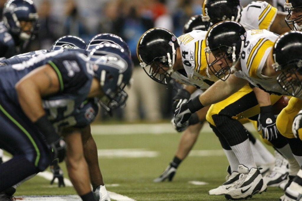 The Pittsburgh Steelers defensive line prepares for battle during Super Bowl XL.