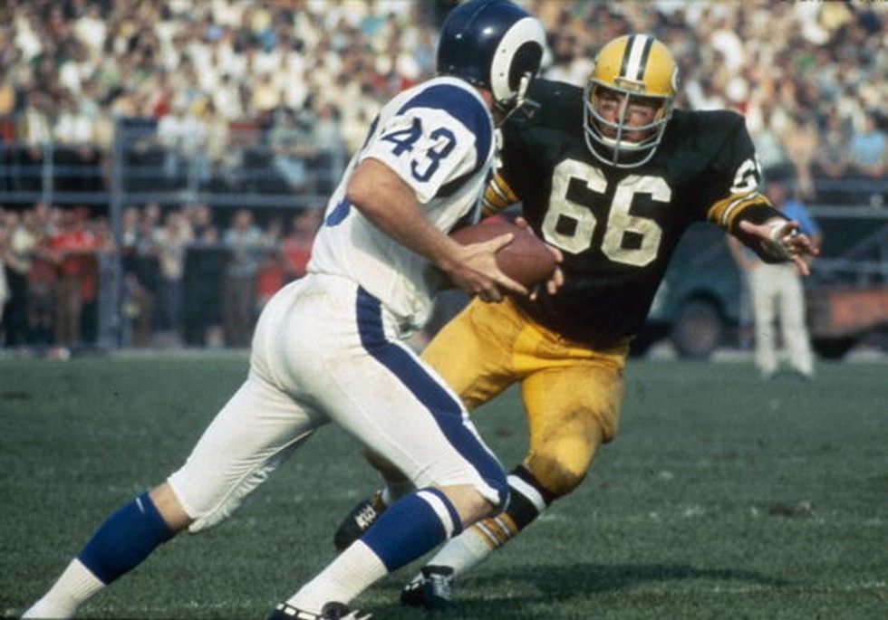 Linebacker Ray Nitschke of the Green Bay Packers chases down a Los Angeles Rams running back.