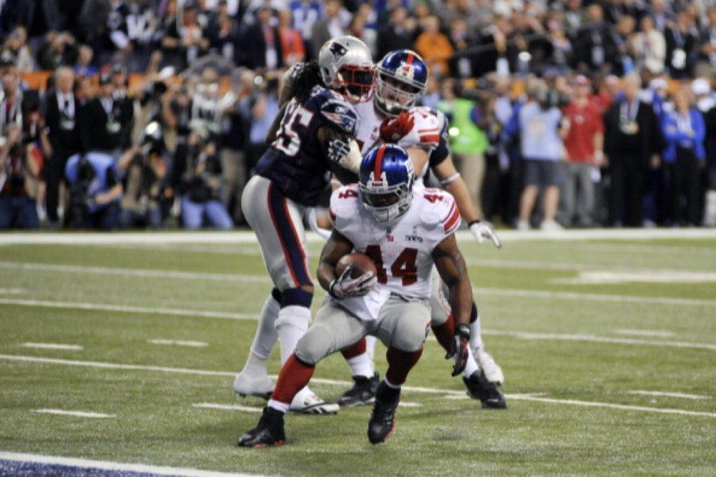 Ahmad Bradshaw of the New York Giants carries the ball against the New England Patriots.