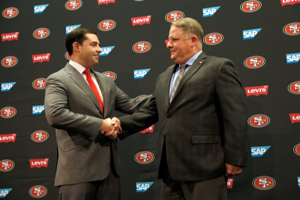 San Francisco 49ers CEO Jed York shakes hands with Chip Kelly after a press conference at Levi's Stadium.