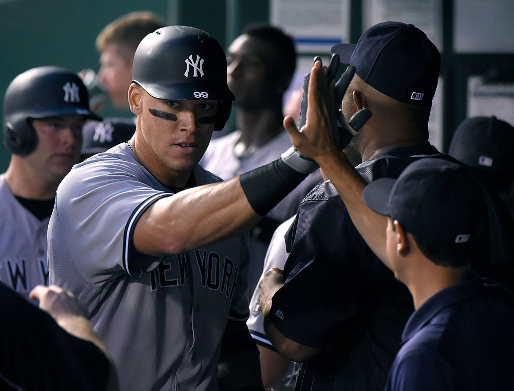 Aaron Judge of the New York Yankees is congratulated by teammates after hitting a two-run home run against the Kansas City Royals