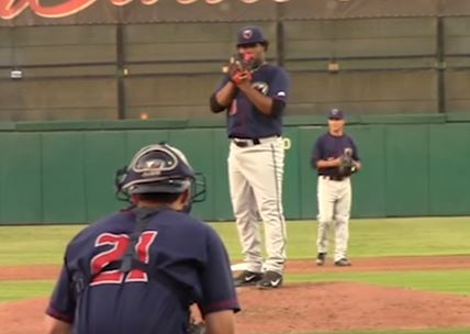 Francis Martes stands on the mound getting ready to pitch