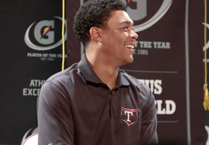 Justus Sheffield smiling during a press conference.