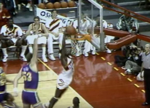 Dominique Wilkins dunks.