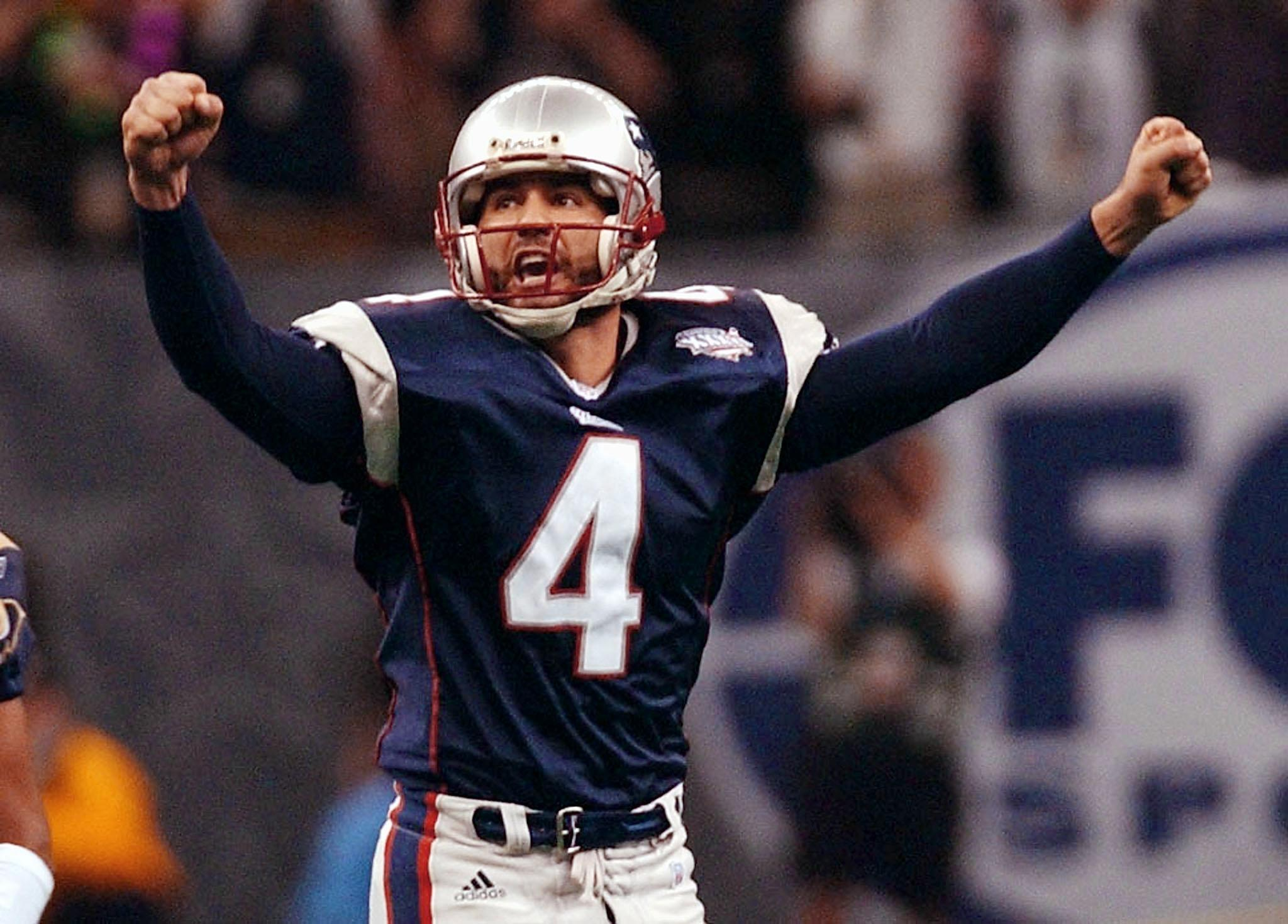 New England Patriots kicker Adam Vinatieri celebrates his game-winning field goal in the second half 03 February, 2002 of Super Bowl XXXVI in New Orleans, Louisiana. The Patriots defeated the St. Louis Rams 20-17 for the NFL championship.