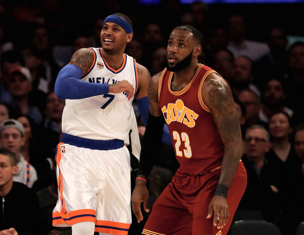 Carmelo Anthony and LeBron James face off on the court.