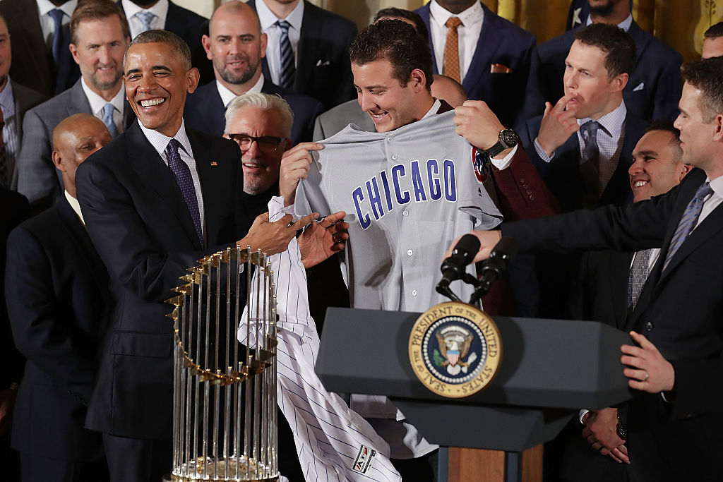 U.S. President Barack Obama (L) receives a uniform from World Series champion Chicago Cubs player Anthony Rizzo during a celebration of the team's win.