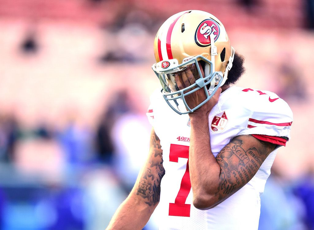 Colin Kaepernick looks frustrated during warmups with his former team.