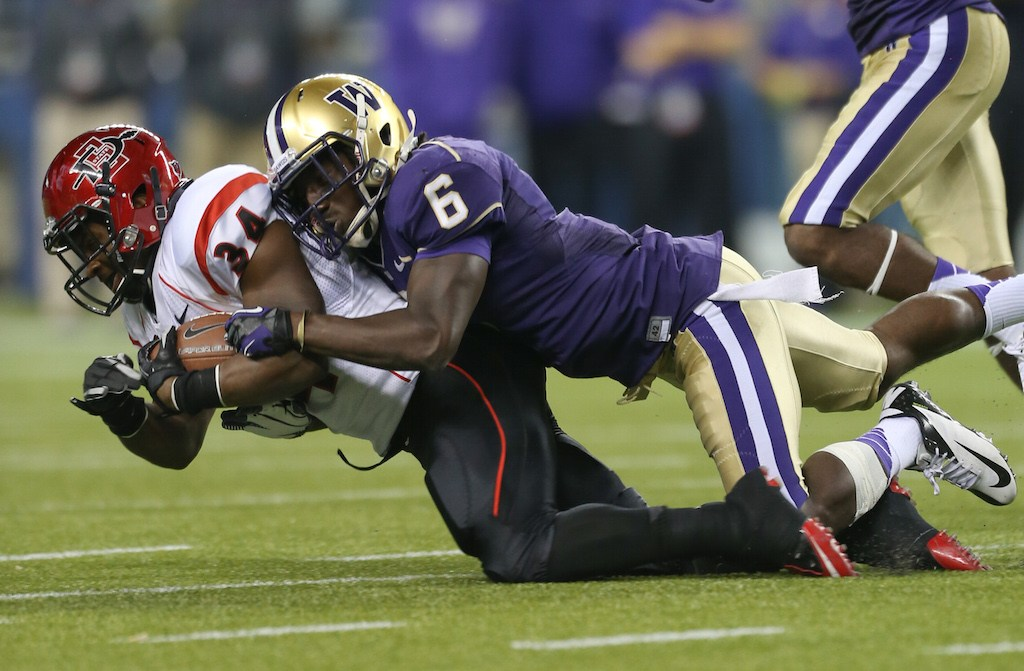 Washington's Desmond Trufant tackles an opponent.