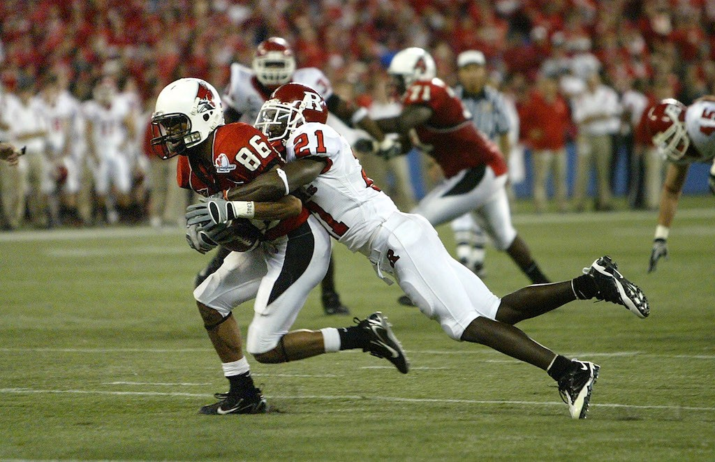Rutgers' Devin McCourty tackles an opposing receiver.