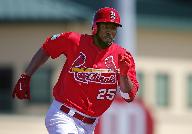 Dexter Fowler sprints toward first base.