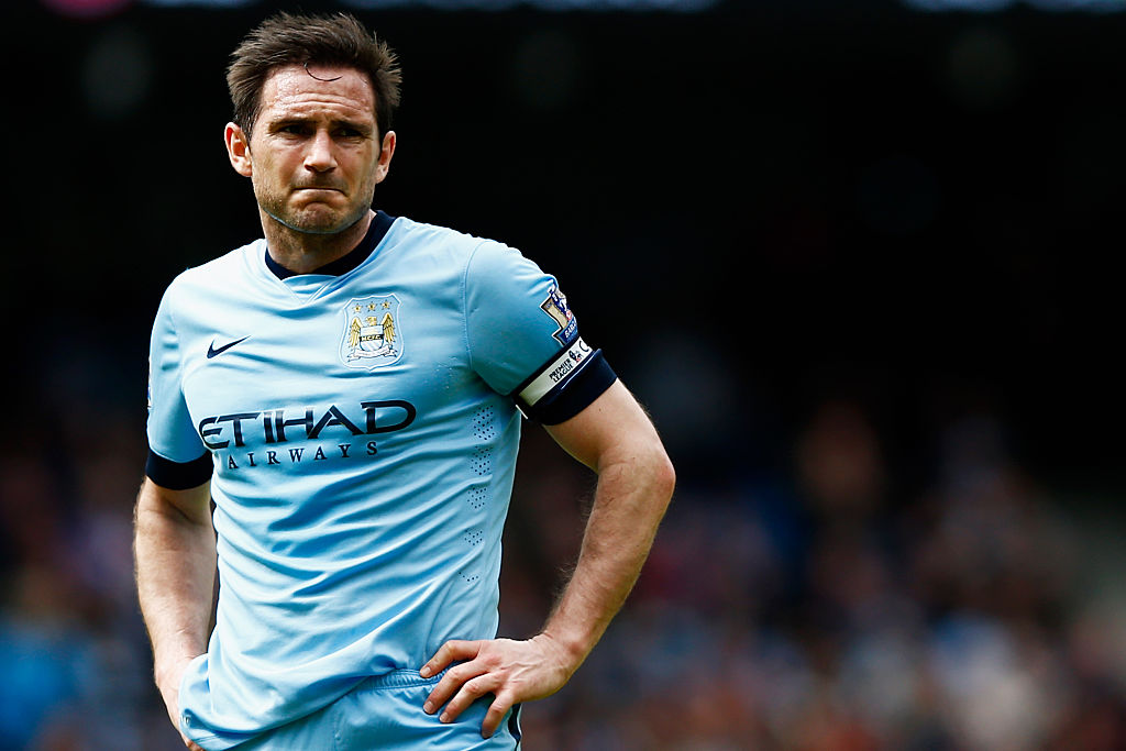 Frank Lampard stands on the field between plays.