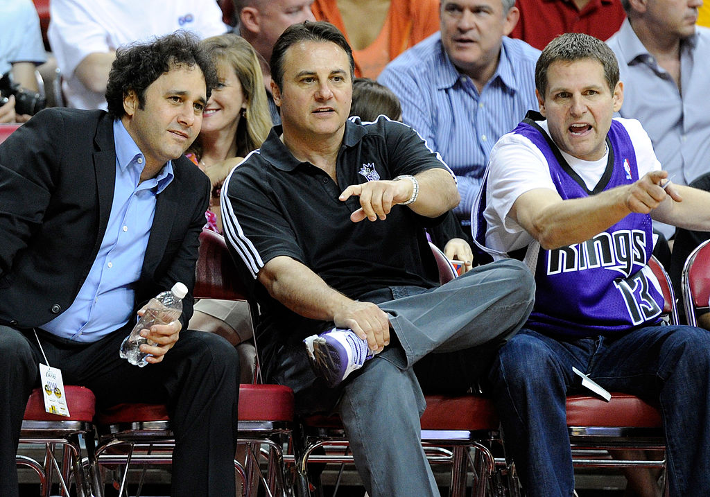 Brothers George Maloof, Gavin Maloof, and Joe Maloof watch a preseason game between the Sacramento Kings and the Los Angeles Lakers.