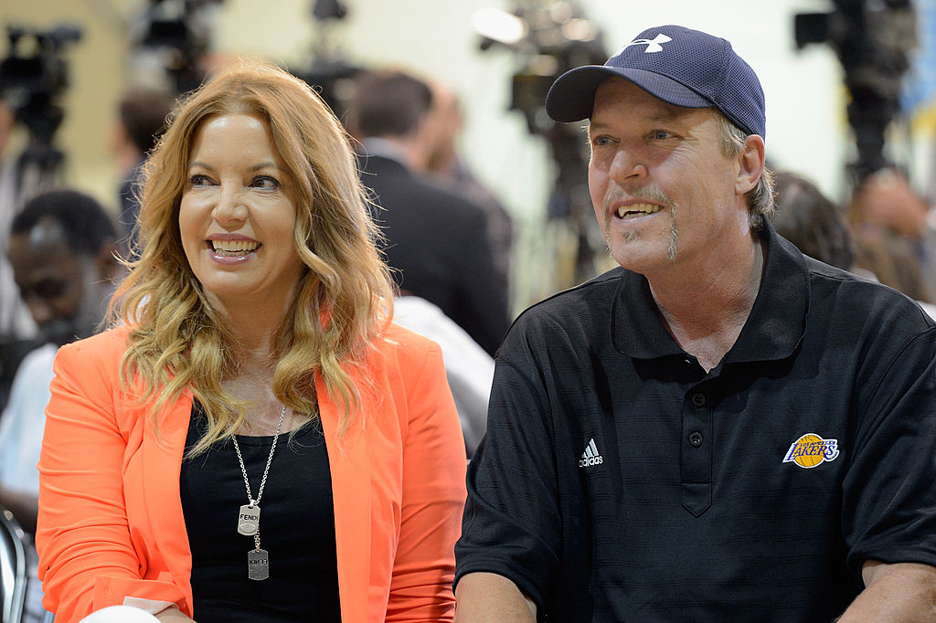 Jim Buss and his sister Jeanie Buss of the Los Angeles lakers attend a news conference.