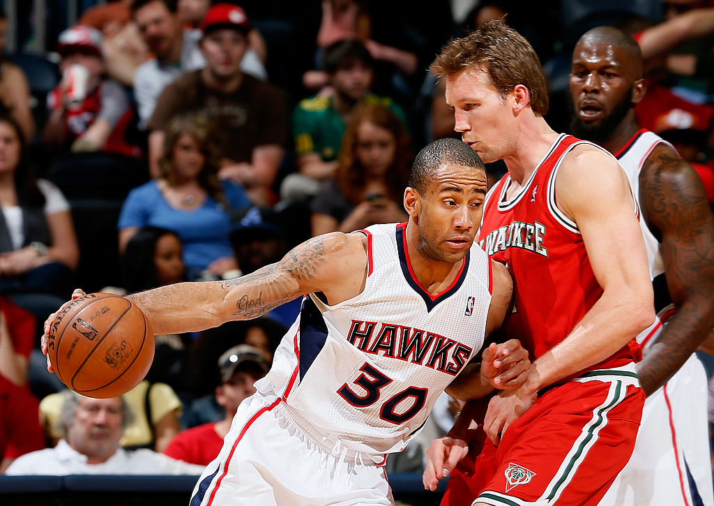 Mike Dunleavy of the Milwaukee Bucks draws an offensive foul from Dahntay Jones of the Atlanta Hawks.