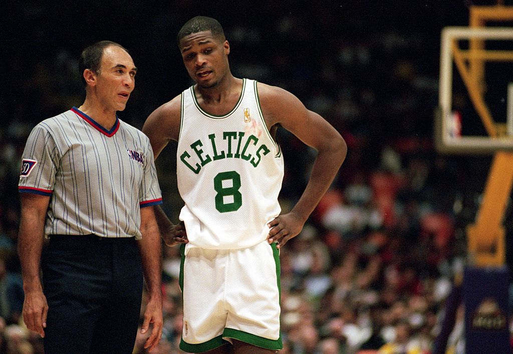 Antoine Walker of the Boston Celtics talks to a referee.