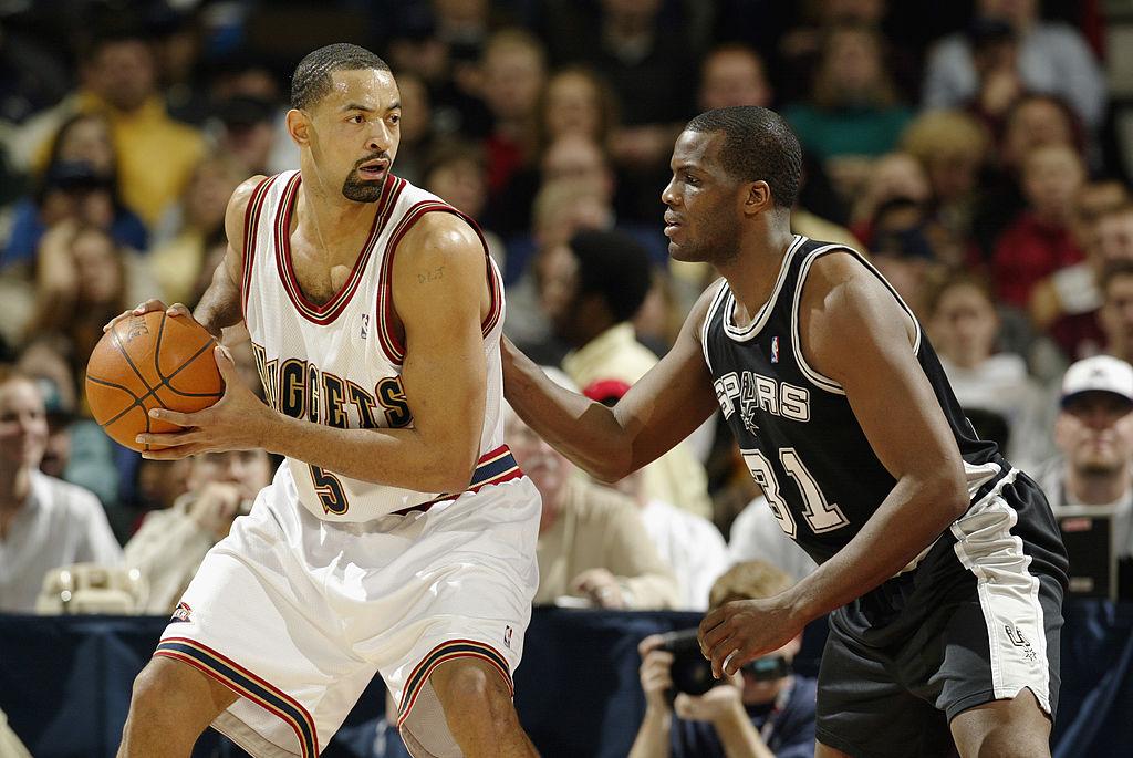 Juwan Howard of the Denver Nuggets posts up against Malik Rose of the San Antonio Spurs.
