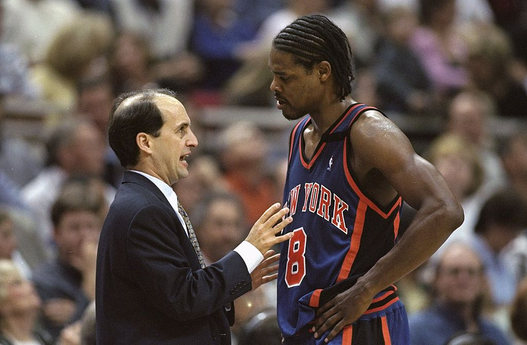 Latrell Sprewell of the New York Knicks listens to head coach Jeff Van Gundy.