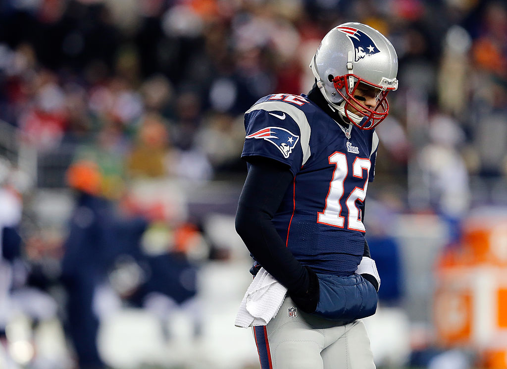 Quarterback Tom Brady of the New England Patriots prepares to take on Peyton Manning.