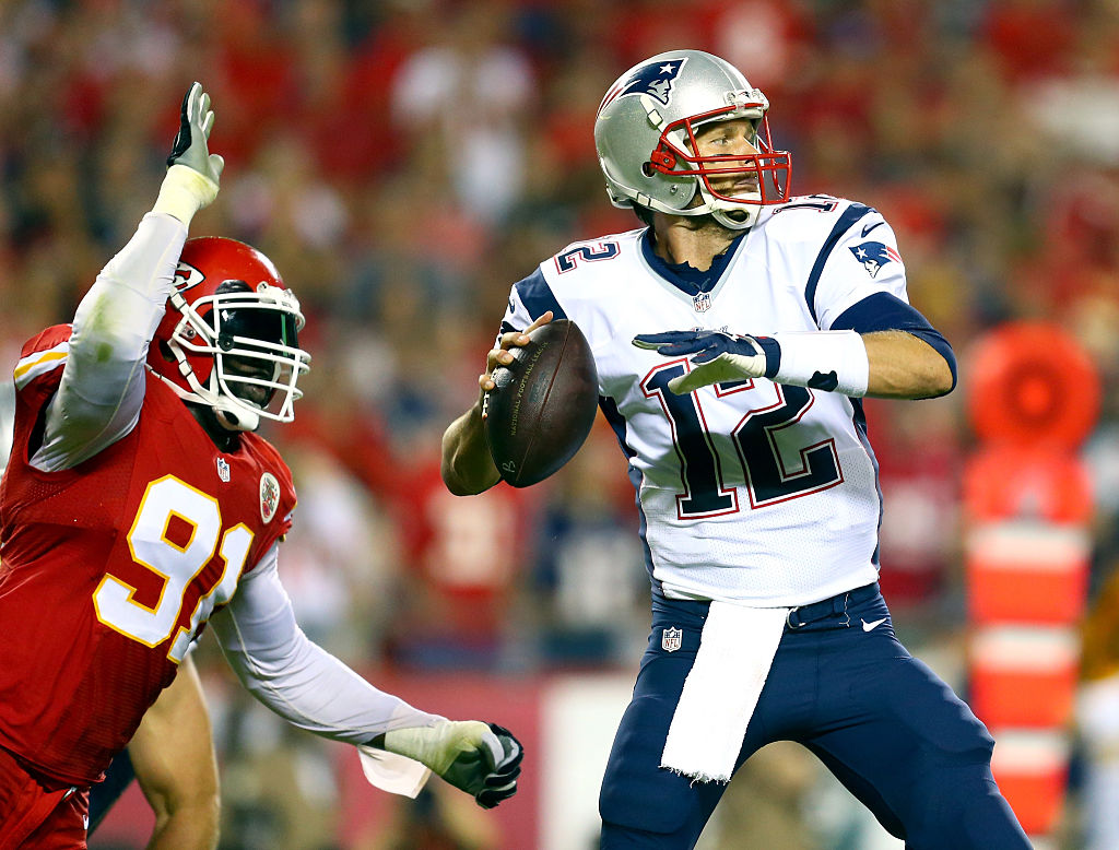 Tamba Hali of the Kansas City Chiefs chases after Tom Brady.