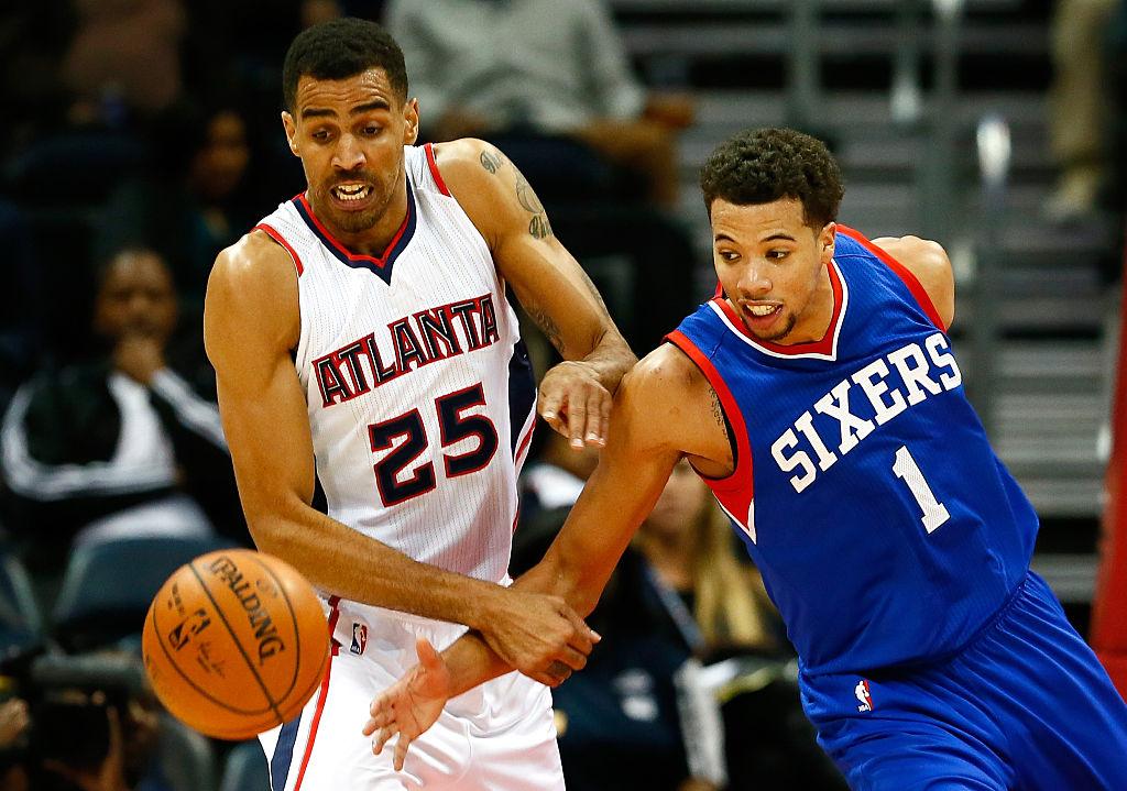 Thabo Sefolosha of the Atlanta Hawks and Michael Carter-Williams of the Philadelphia 76ers battle for a loose ball.