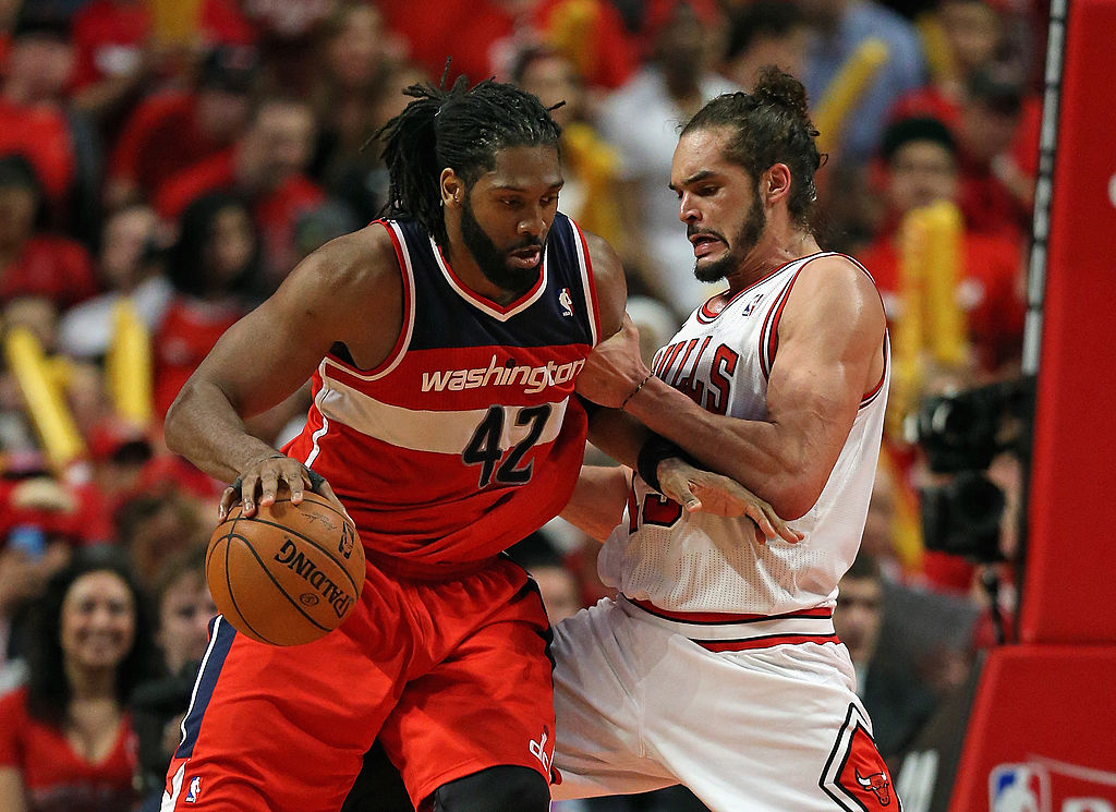 Nene of the Washington Wizards moves against Joakim Noah of the Chicago Bulls.