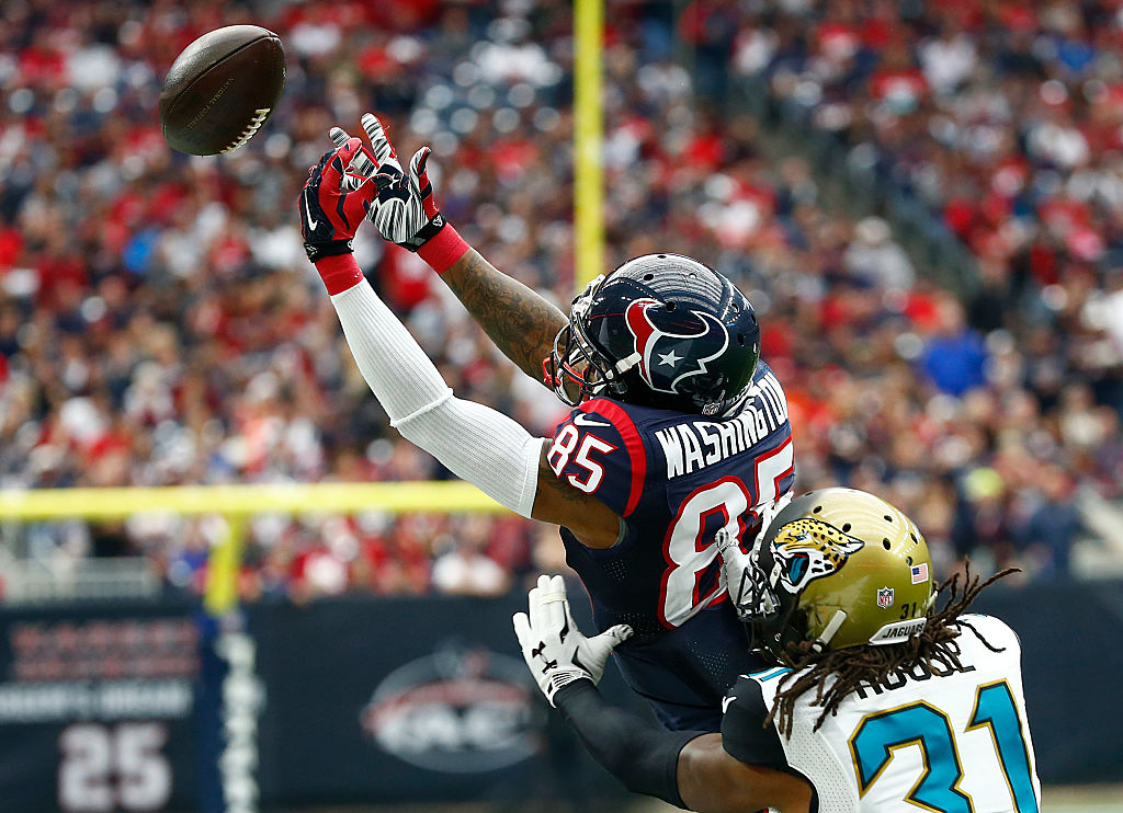 Nate Washington of the Houston Texans reaches for a pass while being covered by Davon House of the Jacksonville Jaguars | Scott Halleran/Getty Images