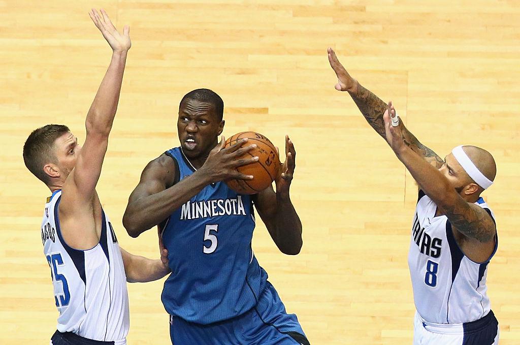 Minnesota Timberwolves center Gorgui Dieng attacks the basket.