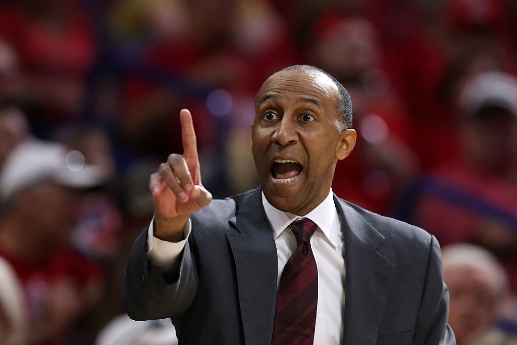 Head coach Johnny Dawkins of the Stanford Cardinals calls out a play.
