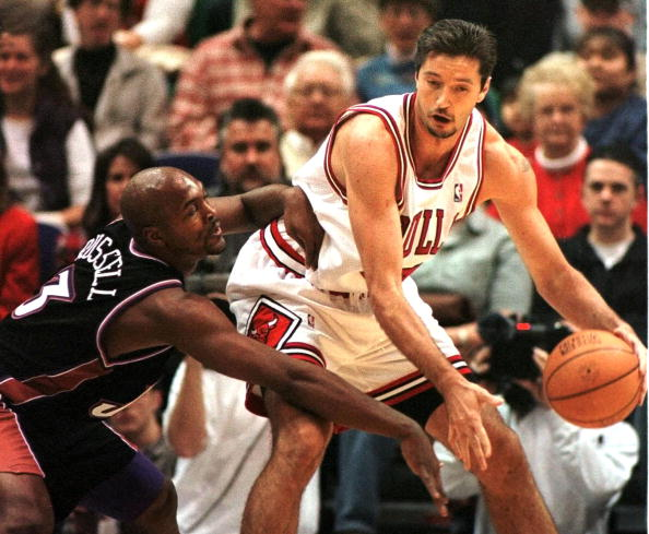Toni Kukoc of the Chicago Bulls tries to fight off Bryon Russell of the Utah Jazz.