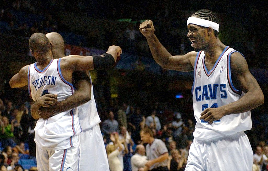 Ricky Davis and his teammates celebrate an overtime victory.