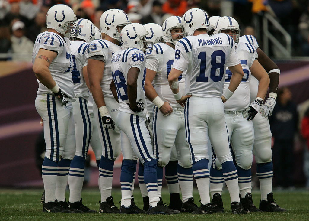 Quarterback Peyton Manning of the Indianapolis Colts leads a huddle while facing the Chicago Bears