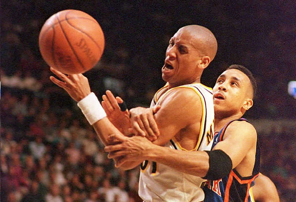 New York Knicks guard John Starks commits a foul on Indiana Pacers guard Reggie Miller.