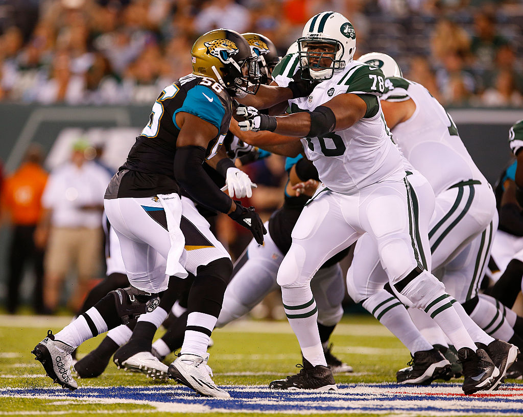 Dante Fowler Jr. of the Jacksonville Jaguars is blocked by Ryan Clady of the New York JetsRich Schultz/Getty Images