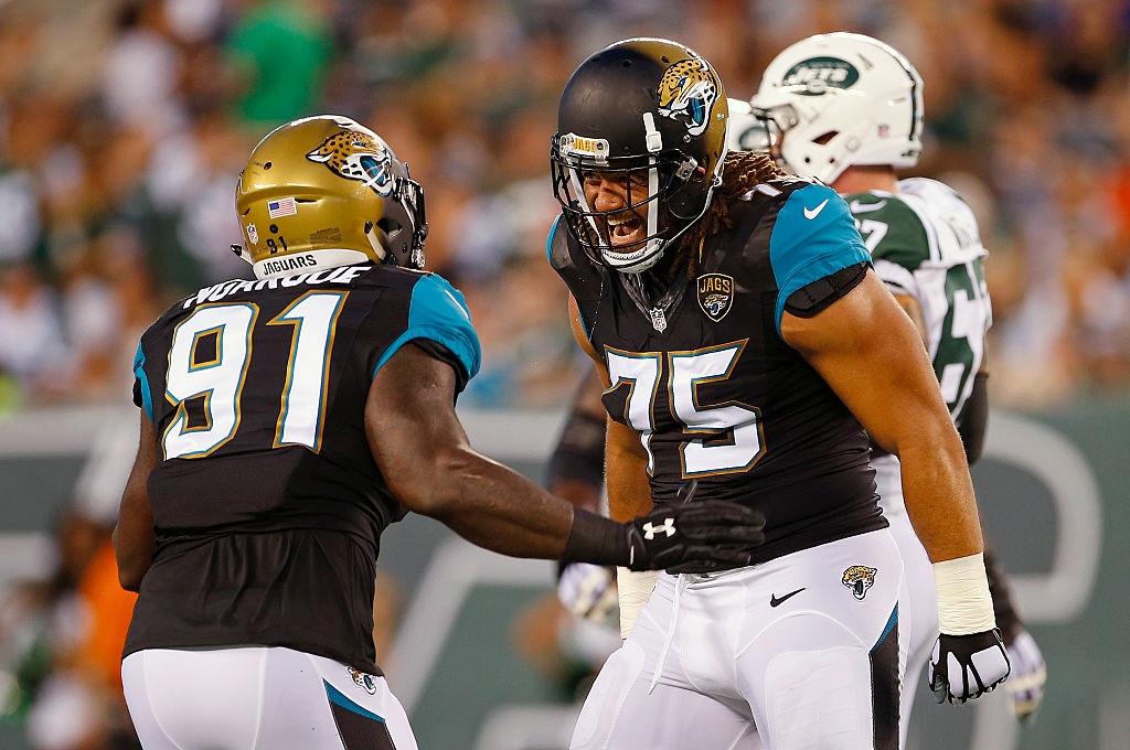 Yannick Ngakoue of the Jacksonville Jaguars celebrates his sack with Jared Odrick | Rich Schultz/Getty Images